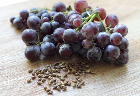 grape seed: Grapes and grape seeds on the table Stock Photo