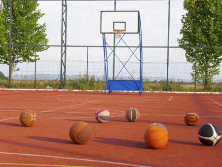 Basketball court and balls photo