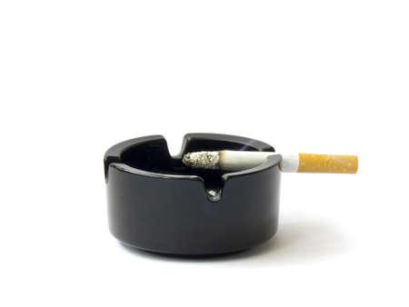 un healthy: Burning cigarette smoking on ashtray-isolated on white Stock Photo