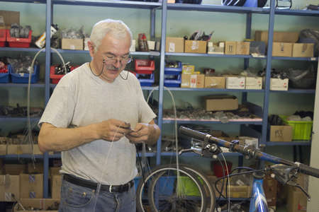 Man repairing bicycle photo