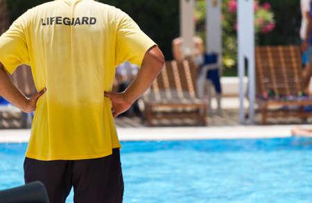 life guard: Lifeguard keeping watch at pool