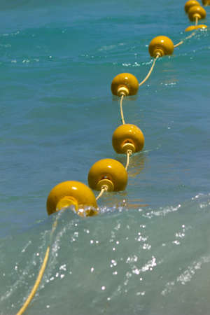 Yellow buoys floating on the sea photo