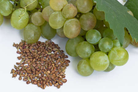 Grape and grape seeds on white background Stock Photo