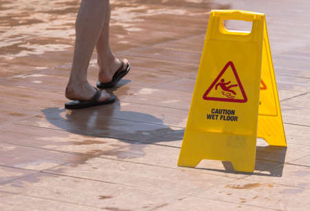 wetness: Warning signs on the slippery floor Stock Photo