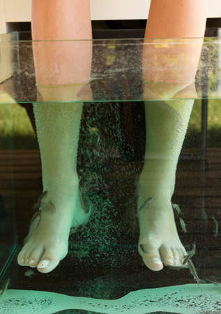 Fish spa treatment.Foot pedicure given by doctor fish -Garra rufa