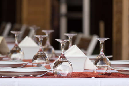 no food: Glasses on the table prepared for dinner in a restaurant