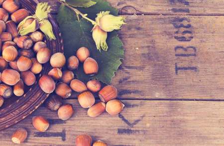 allergic ingredients: Hazelnut in  bowl on wooden background with filter effect retro vintage style