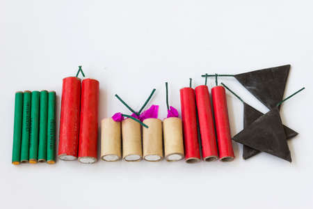 Firecrackers of different types and shapes on a white background Stock Photo