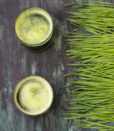 Wheatgrass and glass of green juice- overhead shot