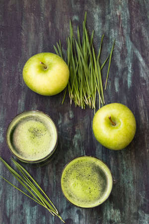 Green juice with wheatgrass and apple Stock Photo