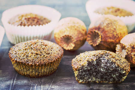 Muffins with poppy seeds on a table Stock Photo