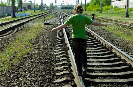 sleepers: Dangerous walk on the rails Stock Photo
