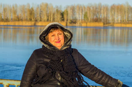 human kind: Portrait of an attractive woman in the background of the river at sunset Stock Photo