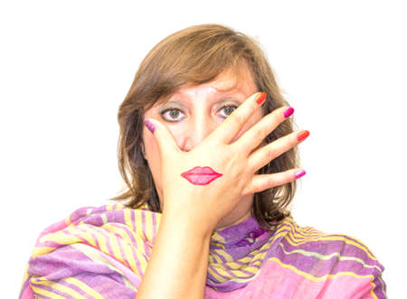 mouth cloth: Funny portrait of a man whose face covers a womans hand with painted lipstick mouth and whose nails covered with nail polish of different colors on white background cloth Stock Photo
