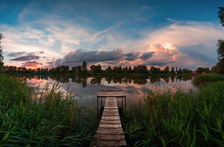 Sunset on the lake on the bridge