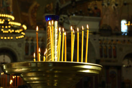candlestick: Candlestick with burning candles in the temple. Russian Orthodox Church Stock Photo