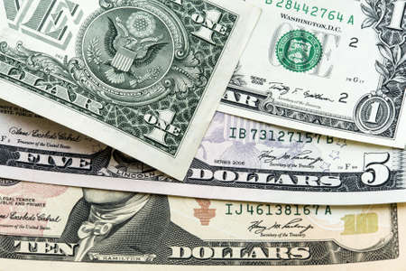 denominations: Dollars, bills of different denominations close-up on a light background