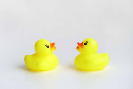 Yellow duck toy on white background. Business, Leadership, Teamwork or Friendship Concept. Photo 写真素材