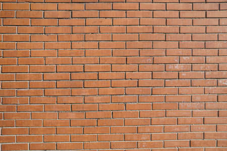 Background of ordinary red brick wall. City photo background