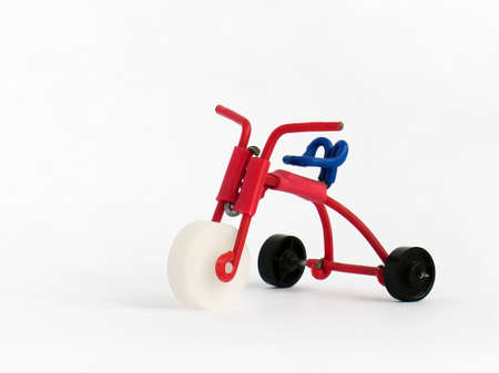 Miniature model of kids bicycle on white background. Icon of old-style bike. Handmade Foto de archivo