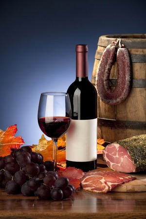 casks: Still life with wine, grapes and meat