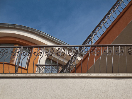 balconies with wrought iron railings