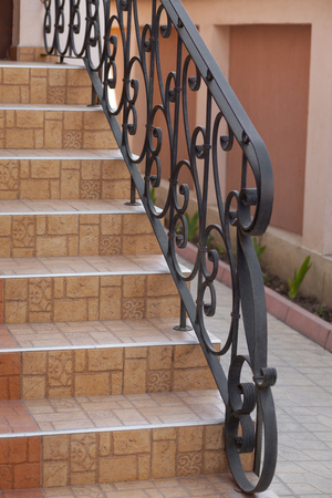 steps of the house, detail of wrought iron railing with beautiful ornaments photo