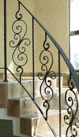 dependable: railing internal stairs in a building made of wrought iron Stock Photo