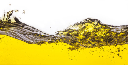 An abstract image of spilled oil . On a white background. photo