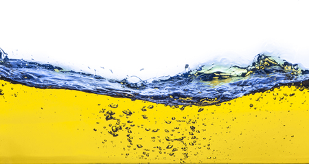abstract image of a yellow liquid spilled  On a white background  Stock Photo
