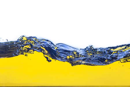 viscosity: abstract image of a yellow liquid spilled  On a white background  Stock Photo