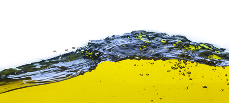 spews: abstract image of a yellow liquid spilled  On a white background  Stock Photo