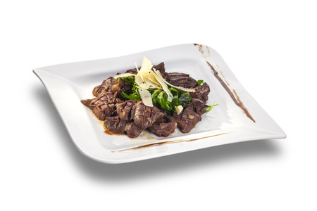 innards: Chicken livers in a creamy sauce with onion and cheese isolated on white plate Stock Photo