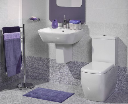 bathrooms: Detail of a modern bathroom with sink and toilet