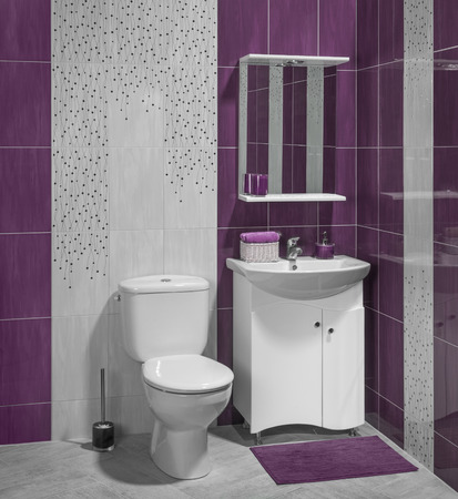 A Luxury Interior Of Modern Bathroom With Sink And Toilet Decorated With  Purple Tiles Photo