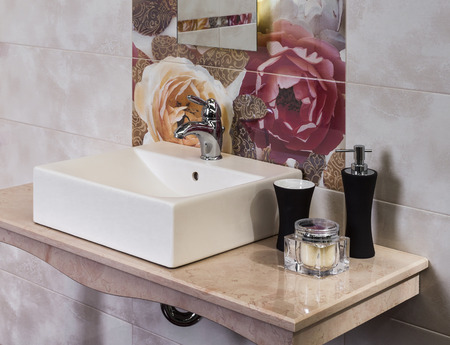 detail of a modern bathroom with tub and sink photo