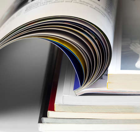 opened book: an opened book over books over gray background