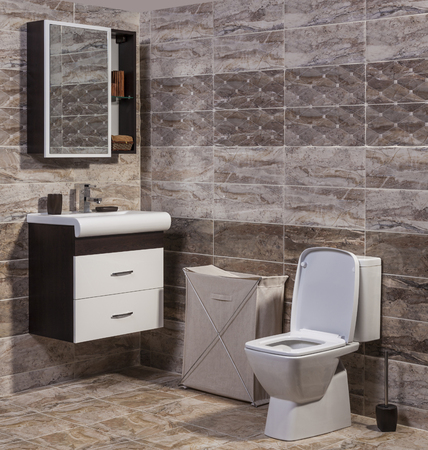 en suite: Inside of fashionable bathroom - toilet and sink Stock Photo