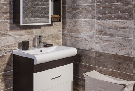 en suite: Inside of fashionable bathroom - toilet and sink and modern ceramic tiles