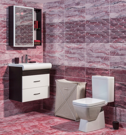 en suite: Inside of fashionable bathroom in red color - toilet and sink