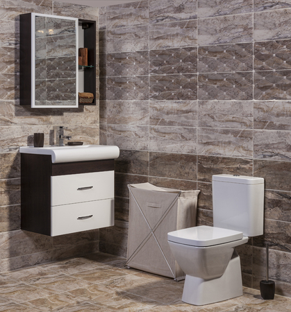 vessel sink: Inside of fashionable bathroom - toilet and sink and modern ceramic tiles