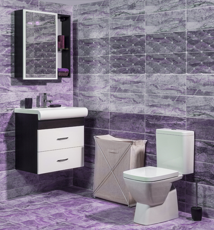 en suite: Inside of fashionable bathroom in purple and gray color - toilet and sink