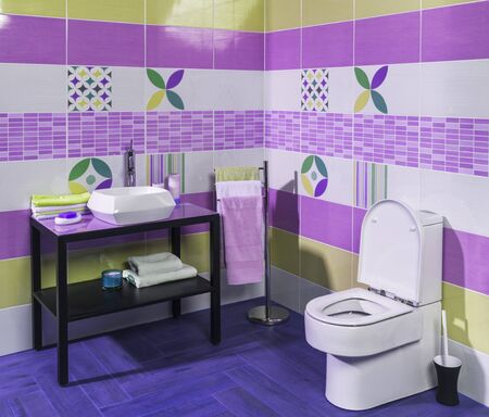 ritzy: Interior of stylish modern bathroom with purple and green tiles Stock Photo