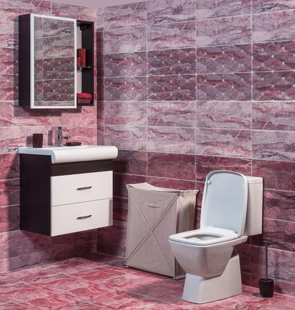vessel sink: Inside of fashionable bathroom - toilet and sink and modern ceramic tiles in red color
