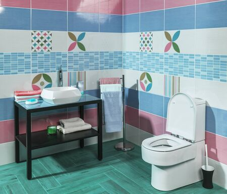 ritzy: Interior of stylish modern bathroom with blue and pink tiles