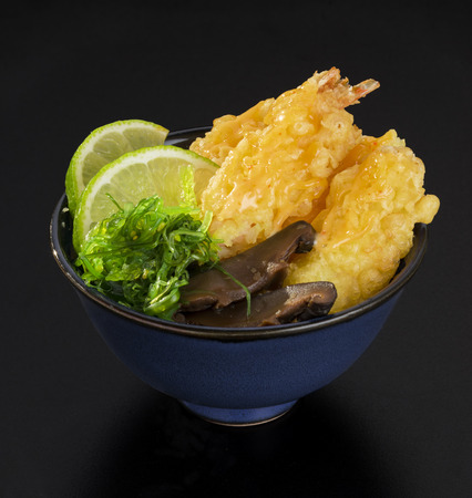 morsels: Shrimp Tempura with fresh salad of seaweed, lemons and mushrooms in a bowl
