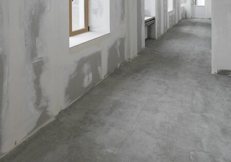 Unfinished apartment interior with concrete floor
