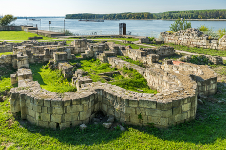 Remains of stone walls of ancient castle Durostorum on the Danube river, Bulgaria Фото со стока