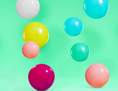 Beautiful colorful ballons with green background