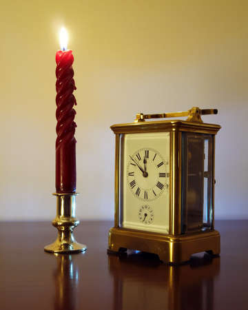 Candle&clock, minutes before twelve photo
